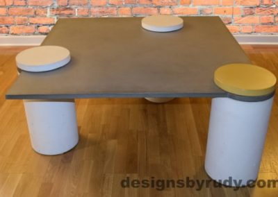 Gray Concrete Coffee Table, White Pillars, one Yellow, two White Caps, Designs by Rudy