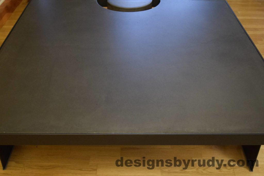 Black Concrete Coffee Table, Black Steel Frame, front edge view, no flash, Designs by Rudy