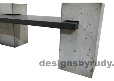 DR CB1 concrete bench on 3 pedestals by Designs by Rudy, partial side view, slab in charcoal concrete and 3 pedestals in gray concrete