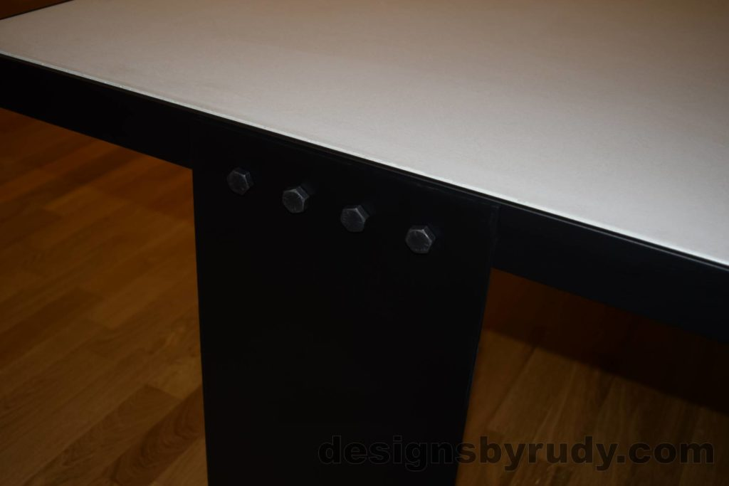 White Concrete Coffee Table, Black Steel Frame, side view of a steel leg and top steel frame joint, Designs by Rudy