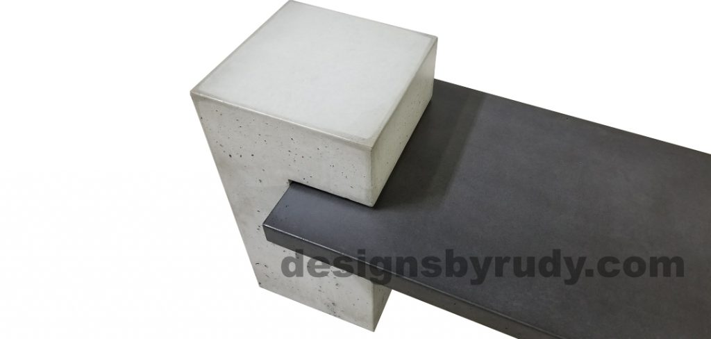 DR CB1 concrete bench on 3 pedestals by Designs by Rudy, partial view of slab in charcoal concrete and single pedestal in gray concrete