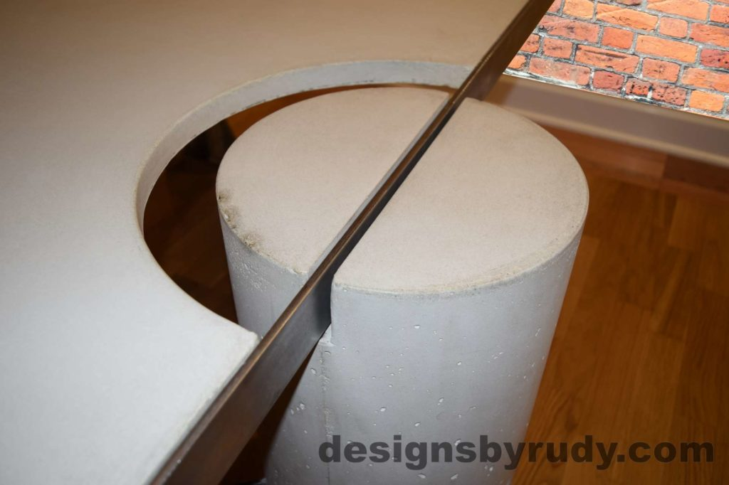 White Concrete Coffee Table, Polished Steel Frame, round leg view closeup no flash Designs by Rudy