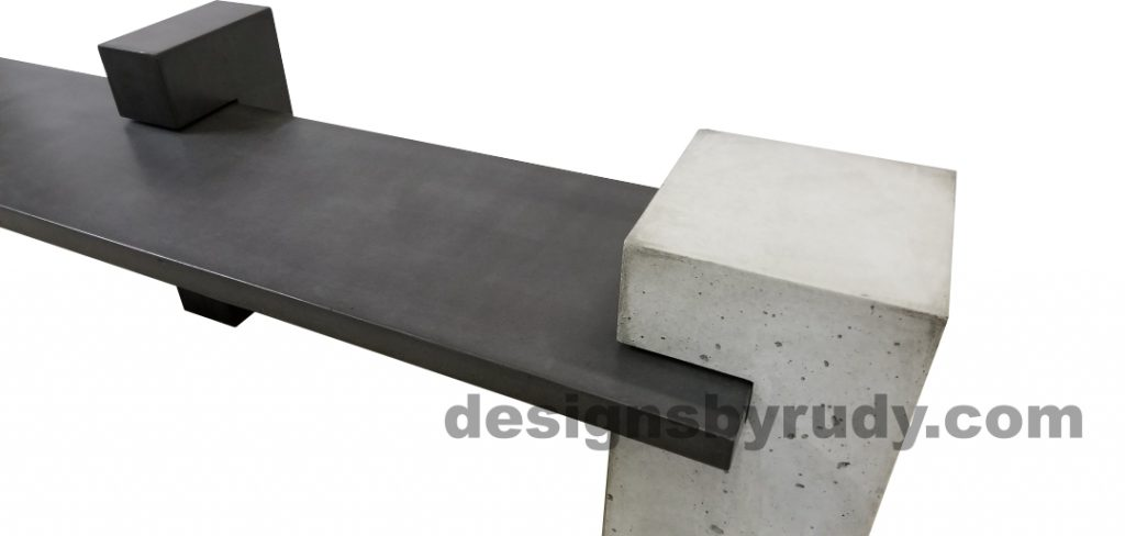 DR CB1 concrete bench on 3 pedestals by Designs by Rudy, partial view of slab in charcoal concrete and on pedestal in gray and one in charcoal concrete