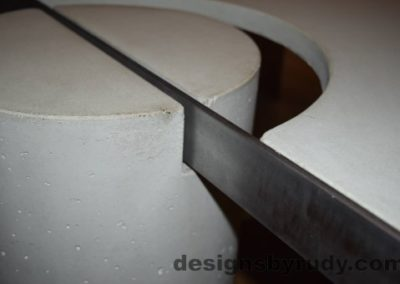 24 White Concrete Coffee Table, Polished Steel Frame, round leg and steel frame joint view closeup with flash Designs by Rudy