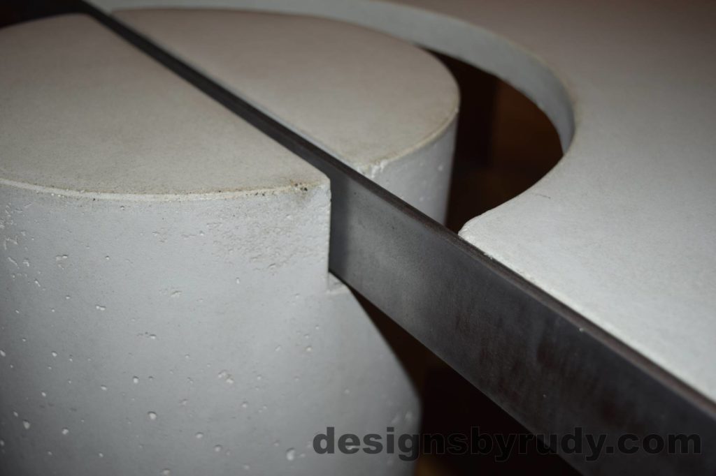 White Concrete Coffee Table, Polished Steel Frame, round leg and steel frame joint view closeup with flash Designs by Rudy