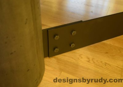 Black Concrete Coffee Table, Black Steel Frame, steel leg and concrete leg joint outside closeup view, Designs by Rudy