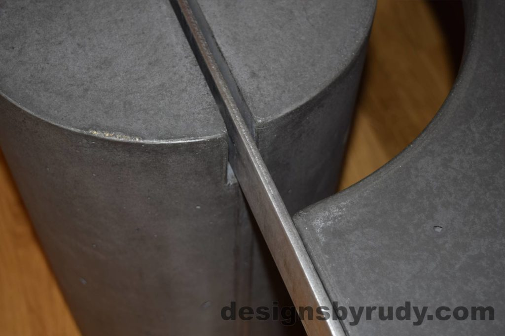 Black Concrete Coffee Table, Polished Steel Frame, frame and leg connection top view closeup, with flash Designs by Rudy