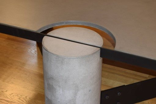 Gray Concrete Coffee Table, Black Steel Frame, angle view of a concrete leg and top steel frame joint, with flash, Designs by Rudy