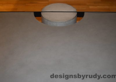 Gray Concrete Coffee Table, Black Steel Frame, straight forward view of a concrete leg and top steel frame joint, Designs by Rudy