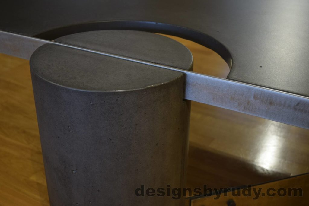 Black Concrete Coffee Table, Polished Steel Frame, frame and leg connection side view, no flash Designs by Rudy