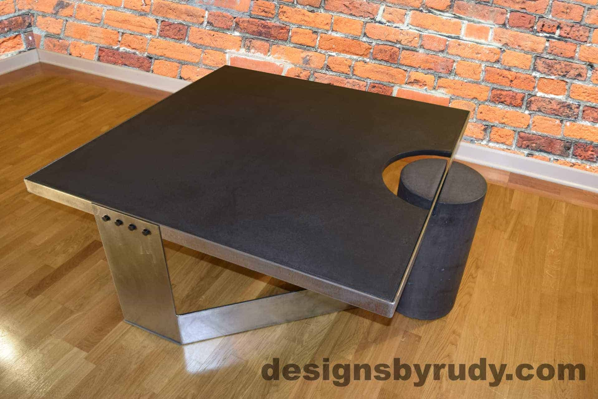 Black Concrete Coffee Table, Polished Steel Frame, top angle view, with flash Designs by Rudy
