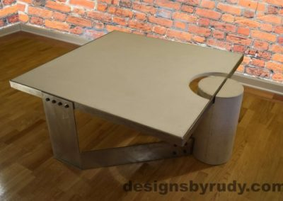 3 White Concrete Coffee Table, Polished Steel Frame, top angle corner and leg round view no flash Designs by Rudy