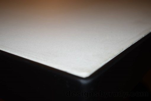 White Concrete Coffee Table, Black Steel Frame, top concrete and steel frame corner detail, Designs by Rudy