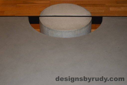 Gray Concrete Coffee Table, Black Steel Frame, straight forward view of a concrete leg and top steel frame joint 2, Designs by Rudy