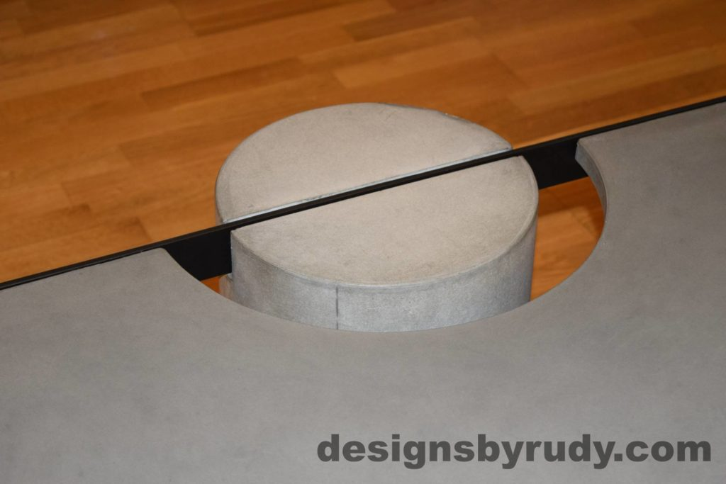 Gray Concrete Coffee Table, Black Steel Frame, top angle view of a concrete leg and top steel frame joint 2, Designs by Rudy