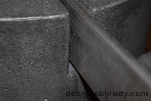 Charcoal Concrete Coffee Table, Polished Steel Frame, frame and leg connection detail closeup, with flash Designs by Rudy