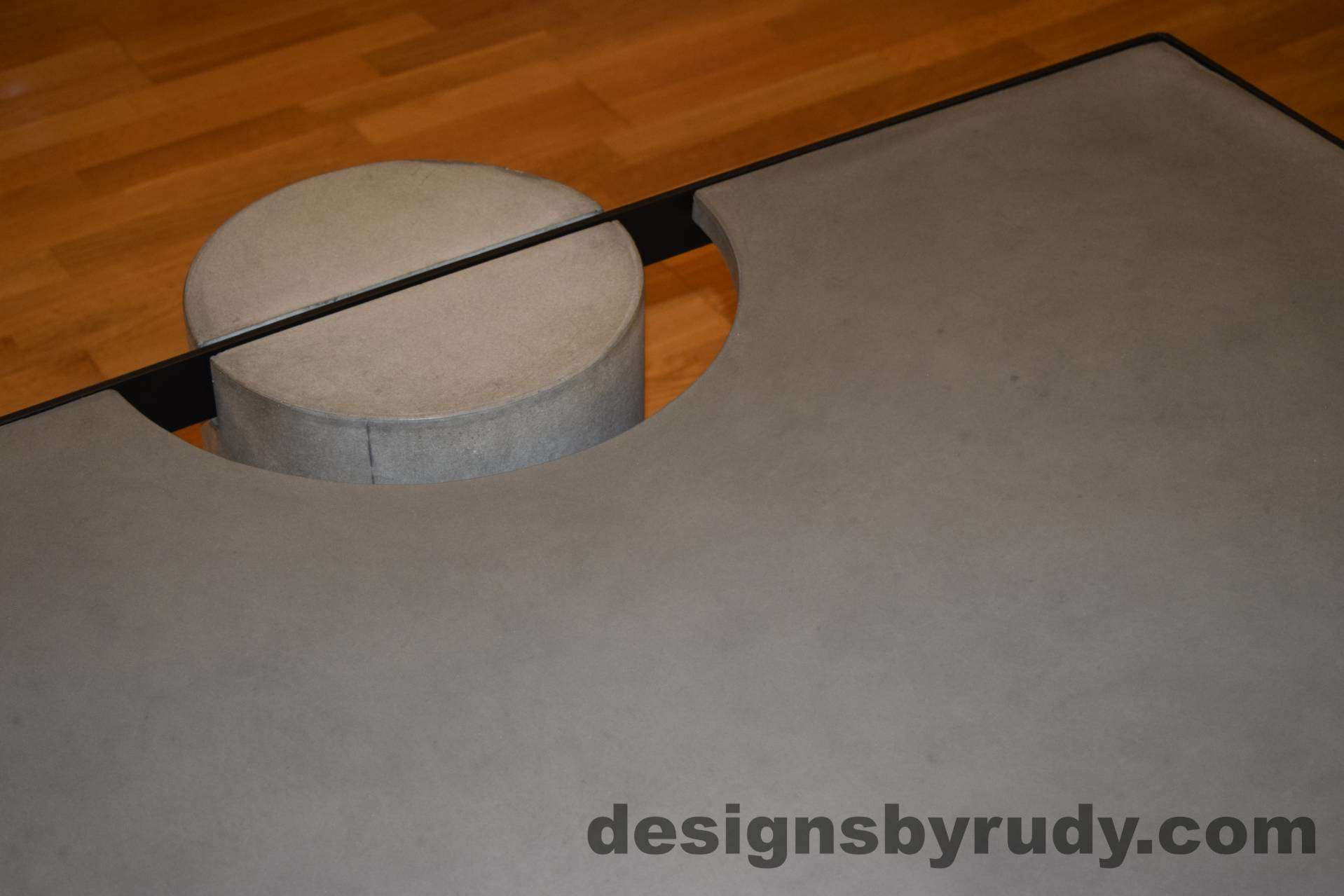 Gray Concrete Coffee Table, Black Steel Frame, top angle view of a concrete leg and top steel frame joint, Designs by Rudy