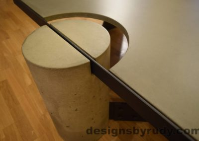 Gray Concrete Coffee Table, Black Steel Frame, top angle view of a concrete leg and top steel frame joint, no flash, Designs by Rudy
