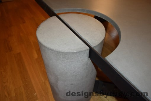 Gray Concrete Coffee Table, Black Steel Frame, top angle view of a concrete leg and top steel frame joint, with flash, Designs by Rudy
