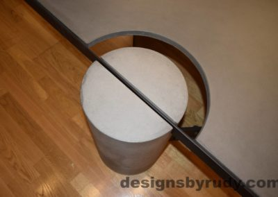 Gray Concrete Coffee Table, Black Steel Frame, top view of a concrete leg and top steel frame joint, Designs by Rudy