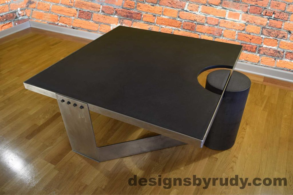 Black Concrete Coffee Table, Polished Steel Frame, top angle view, no flash Designs by Rudy