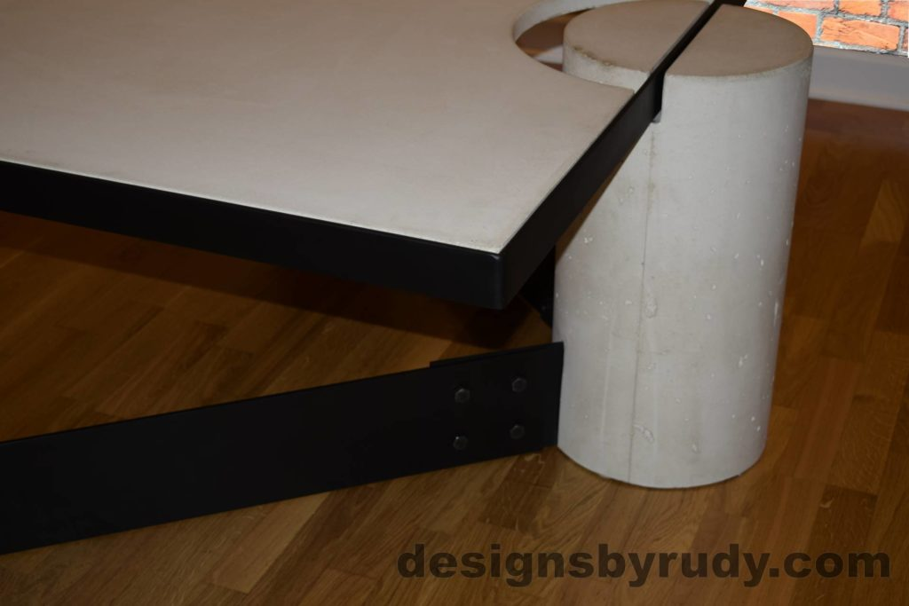 White Concrete Coffee Table, Black Steel Frame, rear top corner and round leg view, Designs by Rudy