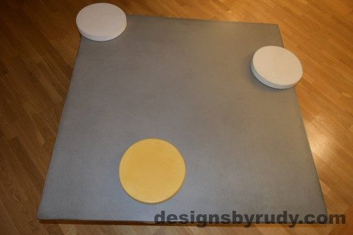 Gray Concrete Coffee Table Top with Tow White and one Yellow Cap, Designs by Rudy