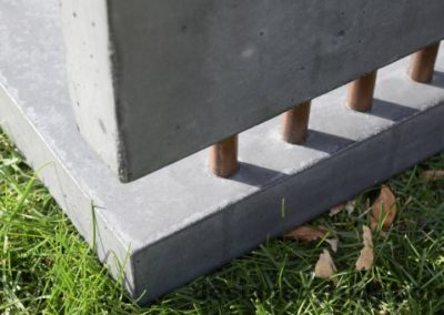43 Gray Concrete Side Table DR0 exterior natural lighting bottom corner copper accent closeup view 2, Designs by Rudy