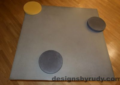 4L Gray Concrete Coffee Table Top with one Yellow and Two Charcoal Caps, Designs by Rudy