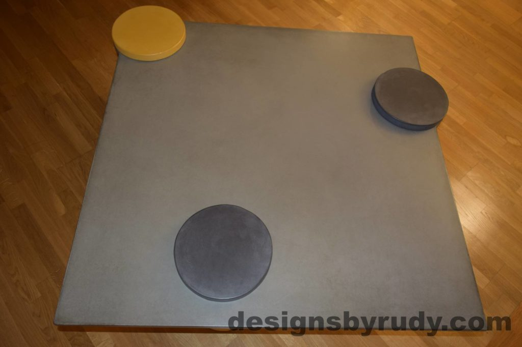 DR18 Gray Concrete Coffee Table Top with one Yellow and Two Charcoal Caps, Designs by Rudy