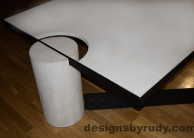White Concrete Coffee Table, Black Steel Frame, top corner and round leg view, Designs by Rudy