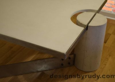 White Concrete Coffee Table, Polished Steel Frame, top angle corner and leg round view closeup no flash Designs by Rudy