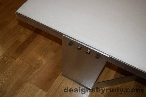 5 White Concrete Coffee Table, Polished Steel Frame, top angle view of a steel leg and frame joint, with flash Designs by Rudy