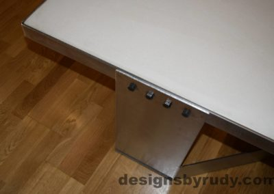 White Concrete Coffee Table, Polished Steel Frame, top angle view of a steel leg and frame joint, with flash Designs by Rudy