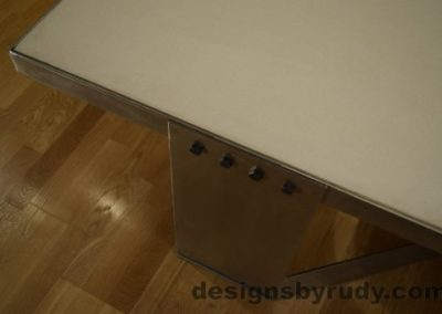 6 White Concrete Coffee Table, Polished Steel Frame, top angle view of a steel leg and frame joint, no flash Designs by Rudy
