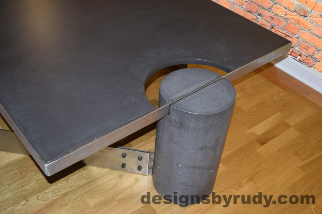 Black Concrete Coffee Table, Polished Steel Frame, top angle view of a round leg, with flash Designs by Rudy