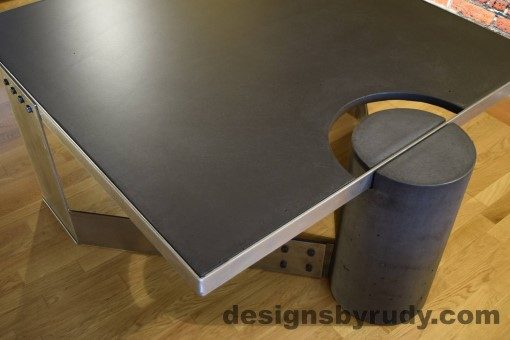 Charcoal Concrete Coffee Table, Polished Steel Frame, top angle corner view of a round leg, with flash Designs by Rudy