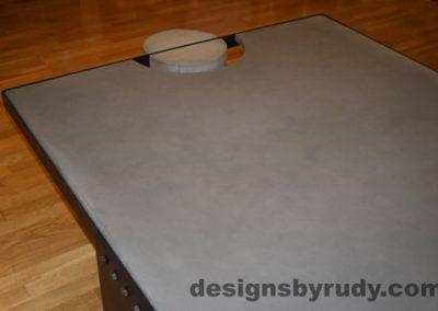 Gray Concrete Coffee Table, Black Steel Frame, angle view, with flash, Designs by Rudy