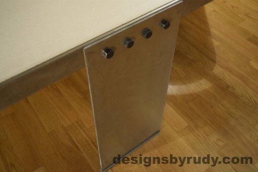 7 White Concrete Coffee Table, Polished Steel Frame, top angle view of a steel leg and frame joint 3, with flash Designs by Rudy