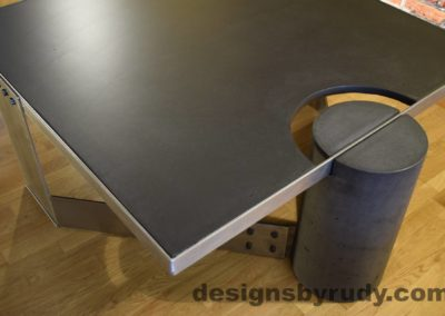 Black Concrete Coffee Table, Polished Steel Frame, top angle corner view of a round leg, with flash Designs by Rudy