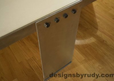 White Concrete Coffee Table, Polished Steel Frame, top angle view of a steel leg and frame joint 3, with flash Designs by Rudy
