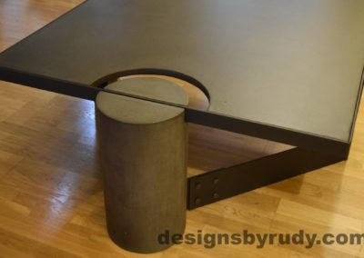 Black Concrete Coffee Table, Black Steel Frame, full round leg side view, no flash, Designs by Rudy