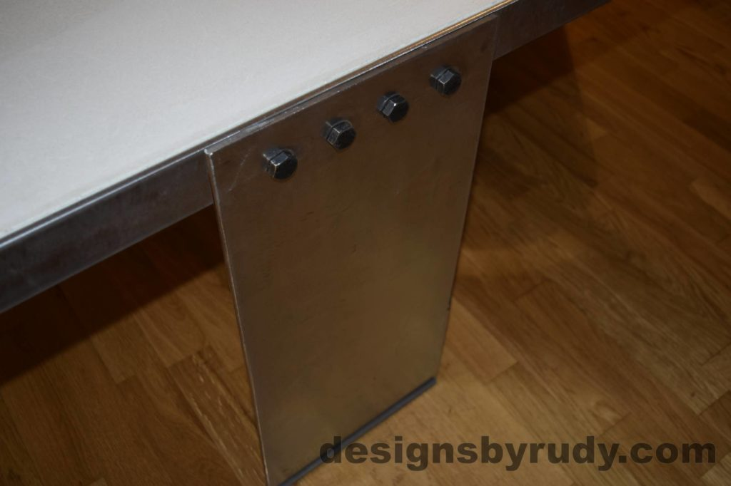 White Concrete Coffee Table, Polished Steel Frame, top angle view of a steel leg and frame joint 2, with flash Designs by Rudy