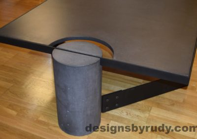 Black Concrete Coffee Table, Black Steel Frame, full round leg side view, with flash, Designs by Rudy