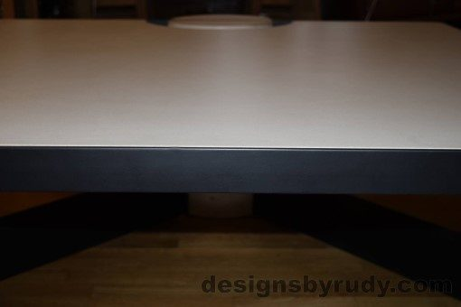 White Concrete Coffee Table, Black Steel Frame, top concrete and steel frame front edge detail, Designs by Rudy