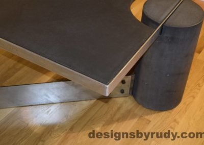 Black Concrete Coffee Table, Polished Steel Frame, frame corner and leg side view, with flash Designs by Rudy