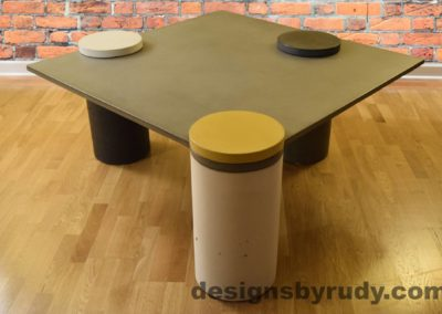 Gray Concrete Coffee Table, White Pillar and Yellow Cap Front, angle view no flash
