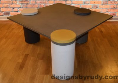 Gray Concrete Coffee Table, White Pillar and Yellow Cap Front, angle view with flash