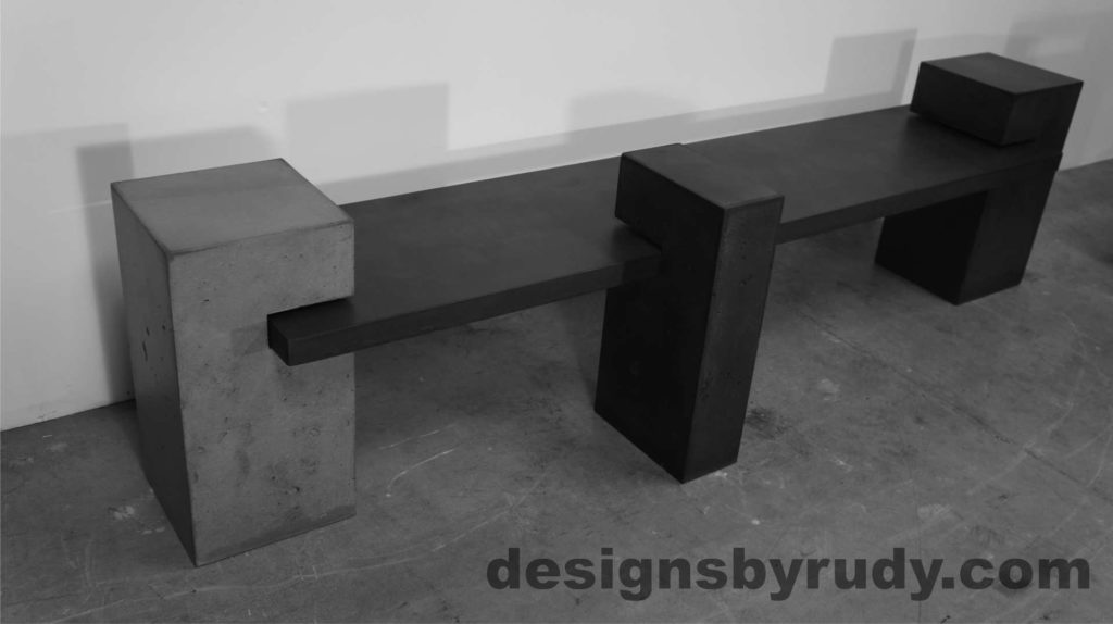 Concrete Bench on three supporting columns, top side angle view. Designs by Rudy