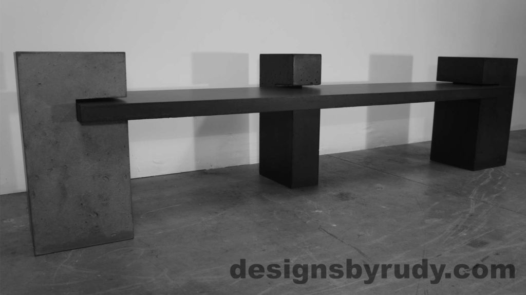 Concrete Bench on three supporting columns, angle view. Designs by Rudy